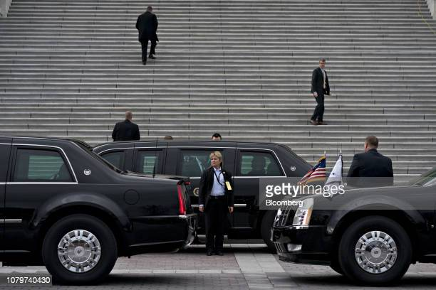 A US Secret Service agent stand outside the presidential limousine known as 'The Beast' as US President Donald Trump not pictured arrives for a...