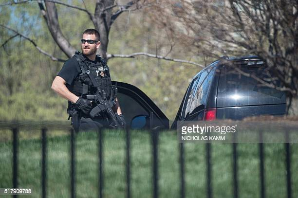 Secret Service agent stands guard at the White House in Washington DC on March 28 2016 The US Capitol and the White House were put on lockdown March...