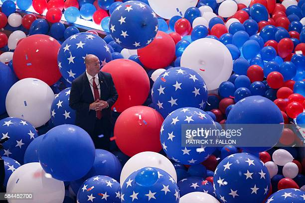 A Secret Service agent stands guard in a sea of balloons after democratic presidential nominee Hillary Clinton accepted her nomination during the...