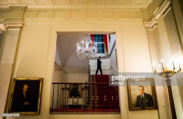 Secret Service agent stands guard on the staircase leading to the White House residence before President Donald Trump and first lady Melania Trump...