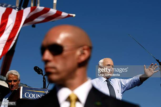 S Secret Service agent stands in front of Republican presidential nominee Sen John McCain as he addresses a campaign rally with Florida Governor...