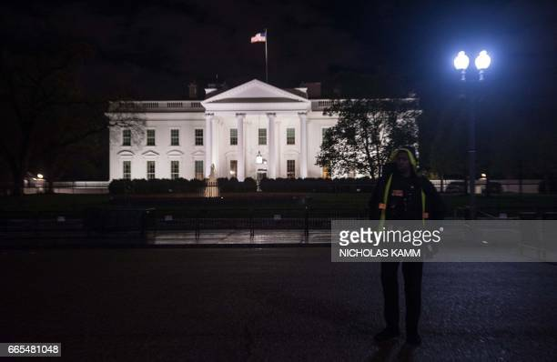 Secret Service agent stands in front of the White House in Washington DC on April 6 2017 after the US fired Tomahawk missiles on Syria following an...