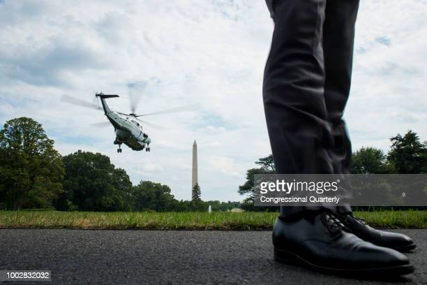 Secret Service agent stands on the South Lawn as President Donald Trump makes his way to Joint Base Andrews on Marine One from the White House Friday...