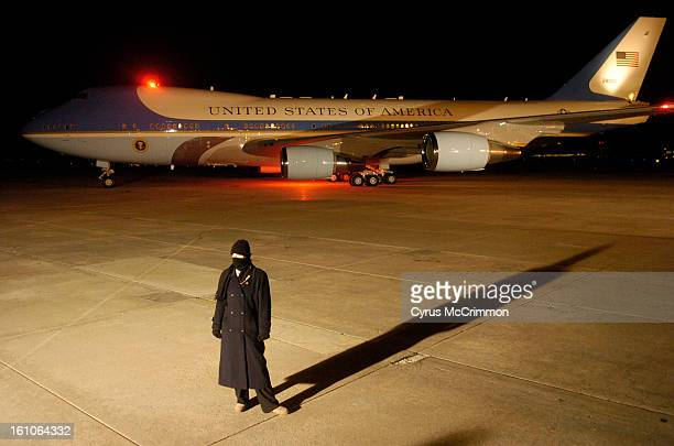 PRESIDENTVISIT_CM07 A Secret Service agent stands on the tarmac as Air Force One with President George Bush leaves Buckley Air Force Base after he...
