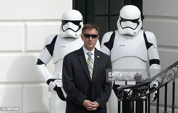 A secret service agent stands still in front of StormTroopers during the annual White House Easter Egg Roll on the South Lawn of the White House...
