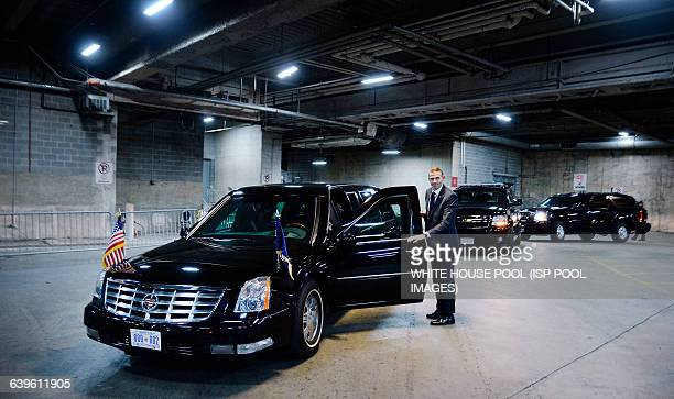 Secret Service Agent stands still next to US President Barack Obama's car named the beast in a underground parking at the Congressional Hispanic...
