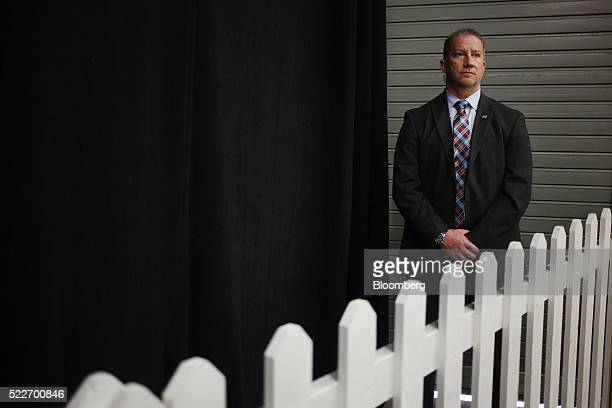 A Secret Service Agent stands watch as Donald Trump president and chief executive of Trump Organization Inc and 2016 Republican presidential...