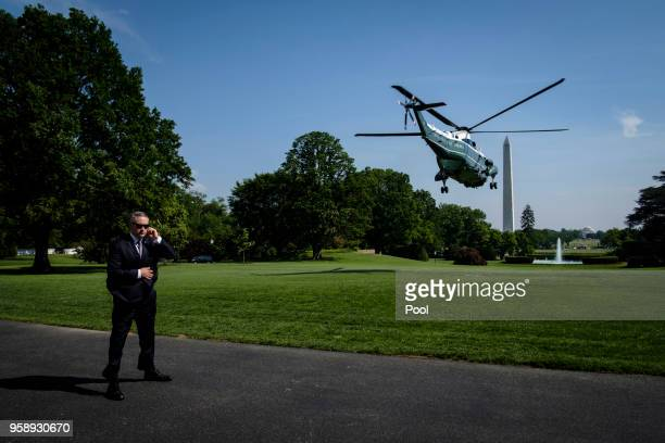 A secret service agent stands watch as President Donald Trump travels aboard Marine One on the South Lawn of the White House on May 15 2018 in...