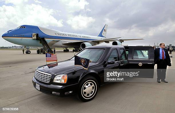A secret service agent waits for US President George W Bush near the Presidential limousine and Air Force One at Fort Smith Regional Airport