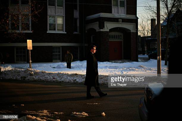Secret Service agent walks near the motorcade during a campaign event December 18 2007 in Waterloo Iowa Former US President Bill Clinton and former...