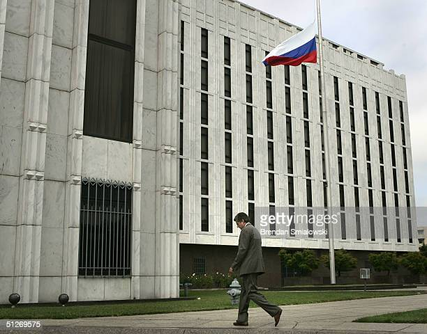 Secret Service agent walks past the Russian Embassy where the flag flew at half staff during a condolences book signing September 7 2004 in...
