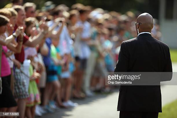 S Secret Service agent watches a group of guests as President Barack Obama departs the White House on the South Lawn July 10 2012 in Washington DC...