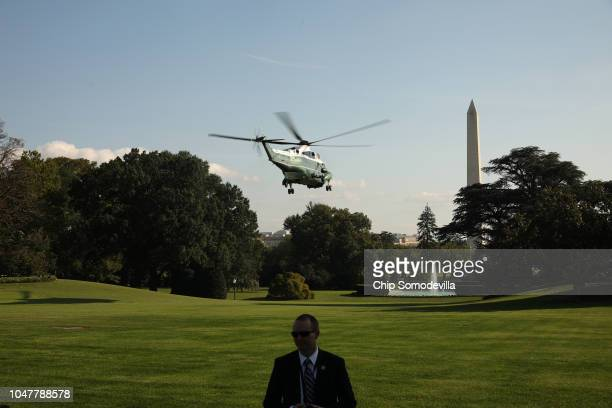 S Secret Service Agent watches journalists as President Donald Trump lifts off from the South Lawn and departs the White House on board Marine One...