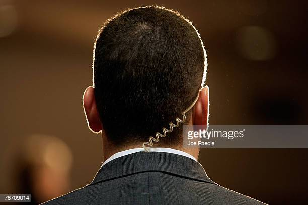 A secret service agent wears an earpiece as Democratic presidential candidate Sen Hillary Clinton speaks during a campaign stop at the Mississippi...