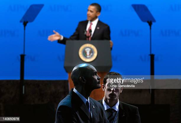 S Secret Service agents and Israeli security officers watch the audience while President Barack Obama addresses the American Israel Public Affairs...