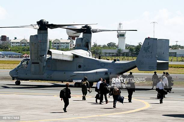 Secret Service agents boarding a U.S. Marine Osprey as they head out to follow U.S. President Oabama on Marine One. President Barrack Obama arrives...