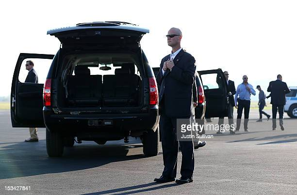 S Secret Service agents guard vehicles in the motorcade of Republican presidential candidate former Massachusetts Gov Mitt Romney on October 5 2012...
