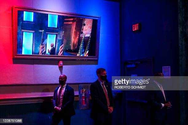 Secret Service agents keep watch as Democratic presidential nominee and former Vice President Joe Biden delivers a speech at a local theater in...