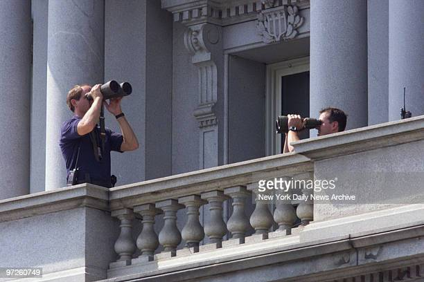Secret Service agents keep watch from a balcony in the Old Executive Office building as President Bill Clinton walked over from the White House for a...