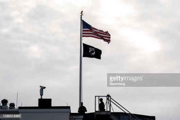 Secret service agents on the roof of the White House in Washington, D.C., U.S., on Friday, Sept. 17, 2021. Biden is hosting the virtual discussion of...