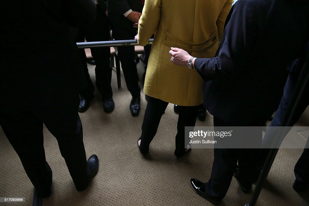 U.S. Secret Service agents stand guard behind democratic presidential candidate former Secretary of State Hillary Clinton after she delivered a counterterrorism address at Stanford University on March 23, 2016 in Stanford, California. A day after terror attacks left dozens people dead in Brussels, Hillary Clinton delivered a counterterroism speech.