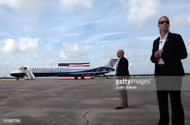 S Secret Service agents stand guard near the new campaign plane of Republican presidential candidate former Massachusetts Gov Mitt Romney during an...