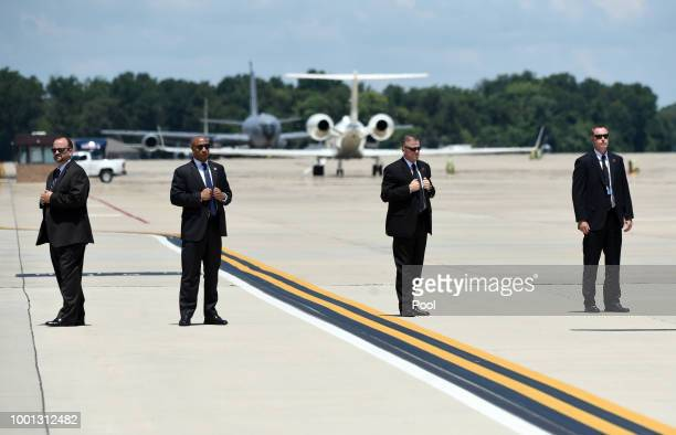 Secret Service agents stand watch as President Donald Trump and first lady Melania Trump arrive to pay their respects to the family of fallen United...