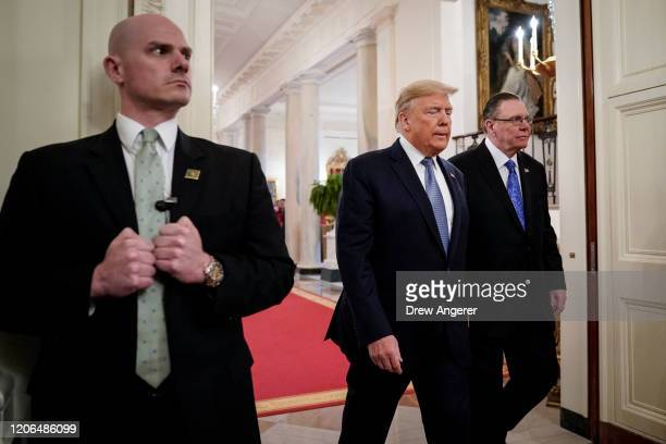 A Secret Service agents stands as US President Donald Trump and retired fourstar Army general Jack Keane arrive for a ceremony to present the...