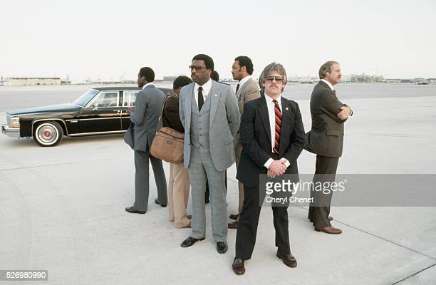 Secret service agents surround Jesse Jackson Baptist minister and candidate for the Democratic presidential nomination in 1984 while he gives an...