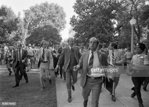 Secret Service Agents surround US President Gerald R Ford as they rush him towards the California State Capitol following an assassination attempt...
