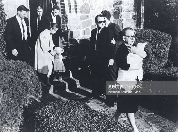 Secret Service agents watch as family members of Lee Harvey Oswald leave the funeral home at Rose Hill Memorial Park in Fort Worth Texas Family...