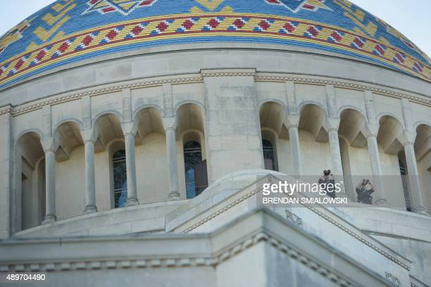 Secret Service counter snipers watch over Pope Francis during a Canonization Mass for Rev Junípero Serra at the Basilica of the National Shrine of...