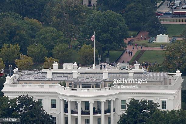 S Secret Service Countersniper Team members stand on the roof of the White House the afternoon that Secret Service Director Julia Pierson resigned...