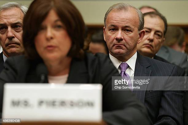 Secret Service Deputy Director AT Smith watchs as Director Julia Pierson testifies to the House Oversight and Government Reform Committee on the...