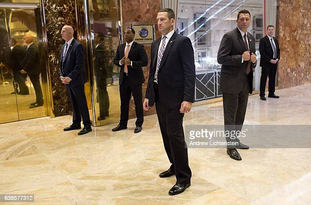 A secret service detail clears out the lobby in the Trump Tower just before a surprise downstairs visit by Donald Trump on January 13 2017 The area...