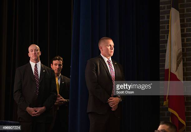 Secret Service detail keeps watch as Republican presidential candidate Donald Trump speaks during a campaign stop at Iowa Central Community College...