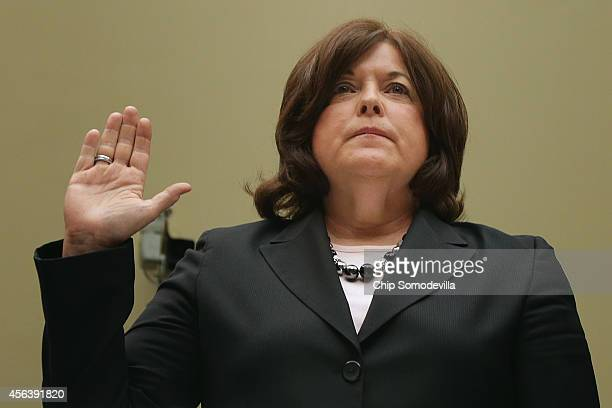 Secret Service Director Julia Pierson is sworn in before testifying to the House Oversight and Government Reform Committee about the White House...