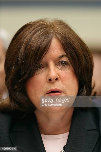 Secret Service Director Julia Pierson prepares to testify to the House Oversight and Government Reform Committee on the White House perimeter breach...
