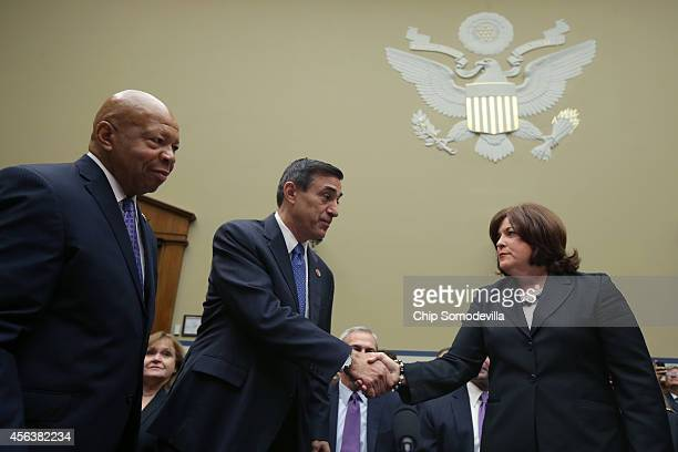 Secret Service Director Julia Pierson shakes hands with chairman of the House Oversight Committee US Rep Darrel Issa as Rep Elijah Cummings looks on...