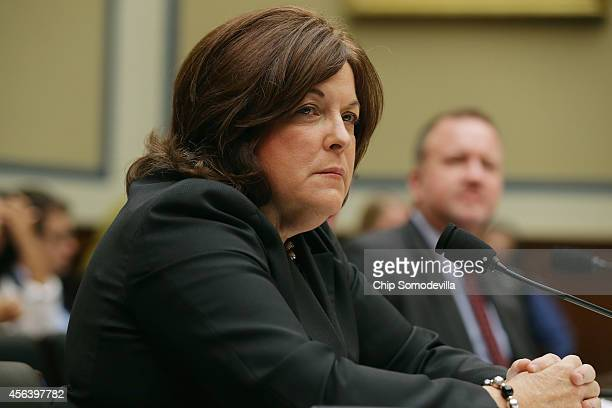 Secret Service Director Julia Pierson testifies to the House Oversight and Government Reform Committee about the White House perimeter breach during...