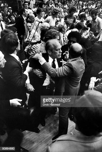 Secret Service Men surround American President Gerald Ford during an incident in which a flashbulb was mistaken for a gun shot while Ford was...