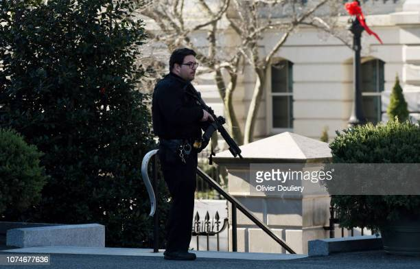 Secret Service officer stands guard near the West Wing at the White House during a lockdown for a suspicious activity near the White House grounds on...