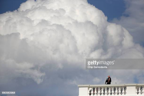 Secret Service officer stands guard on the roof of the White House following a temporary lock down May 31 2017 in Washington DC The reason for the...