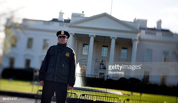 A Secret Service officer stands in front of the White House in Washington DC US on Friday Nov 27 2009 The Secret Service is reviewing whether...