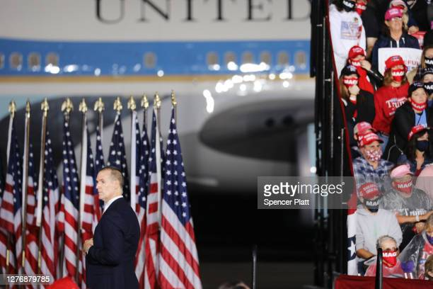 Secret Service officer watches the crowd as President Donald Trump speaks at a rally at Harrisburg International Airport on on September 26 2020 in...