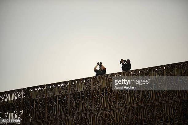 Secret service officers are placed on the roof of the museum before President Obama attends the dedication of the National Museum of African American...
