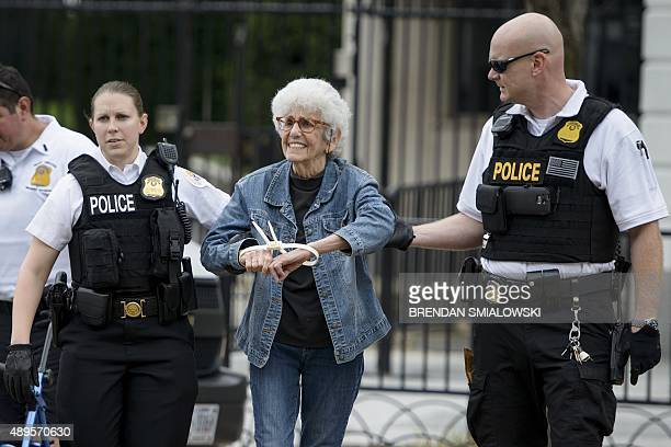 Secret Service officers arrest an activist after she and others tried to deliver a letter protesting militarism climate change and inequality to the...