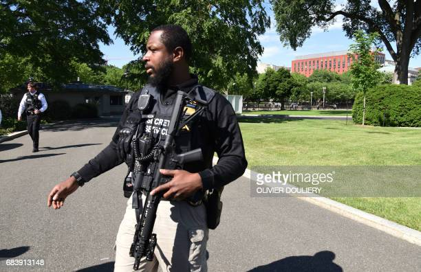 US Secret Service officers deploy on the grounds of the White House on May 16 during a reported security breach The secret service reported a suspect...