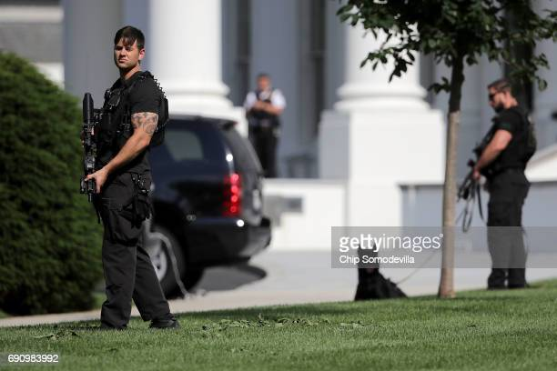 Secret Service officers stands guard on the North Lawn of the White House following a temporary lock down May 31 2017 in Washington DC The reason for...