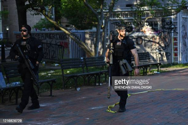 Secret Service snipers return to the White House after standing guard while US President Donald Trump visited St John's Episcopal church across...